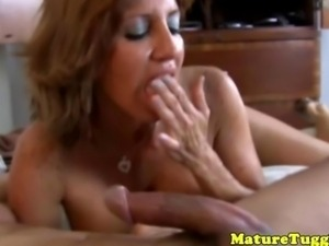 Mature handjob lover handling a massive dick