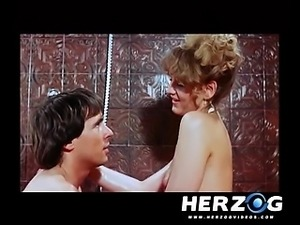 German blonde babe fucked in a retro porn video