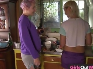 Wild lesbian strap on fuck and cunnilingus in the kitchen