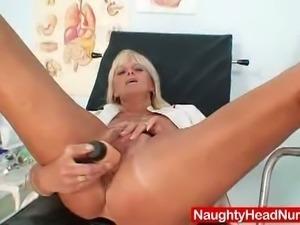 Mature blonde nurse dildos her pink pussy