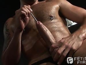 Pierced and hairy stallion Lance Navarro sounds his big dick
