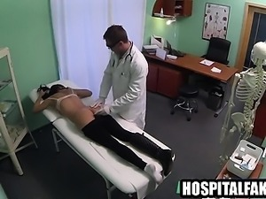 Sexy burnette patient gets massaged by her doctor
