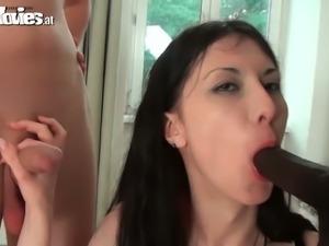 Nasty brunette enjoys white and a black cock