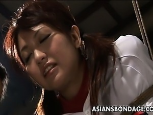 Hot Asian cheerleader enjoys a round of bdsm.