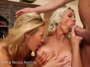 2 hot blondes take turns sucking a huge cock then get sprayed on their tits...