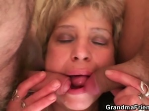 Horny blonde granny takes two hard cocks at once