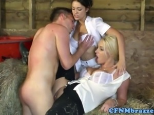 Busty CFNM femdoms fuck and suck the stableboys cock in the hay