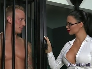 Muscled and tattooed sub male standing in small cage then his mistress with...