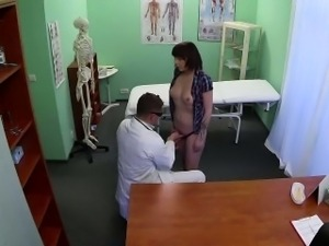 Brunette patient sucking on her doctors hard cock