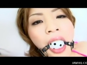 Asian babe yuu gets her both holes toyed deeply.