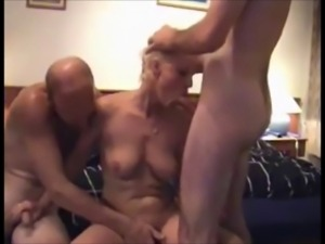 Nice homemade threesome with a mature woman
