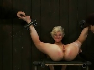 Blondy being tickled while bondaged