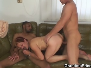 Mature brunette gets banged by two young studs