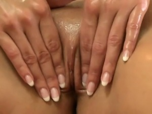 Blonde lesbian babe getting massaged and fingered