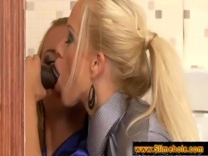 Two blonde secretaries sucking at a hole free