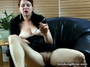 Redhead milf Mina Gorey smokes and poses