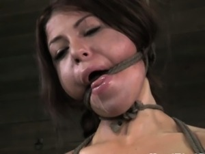 BDSM sub Mia Gold pussy lips clamped