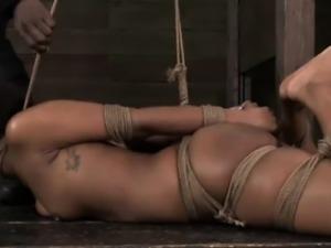 Hogtied ebony sub getting spanked