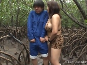 big breasted slut tugs him off in the woods