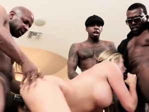Busty sexy blonde on three hard black cocks