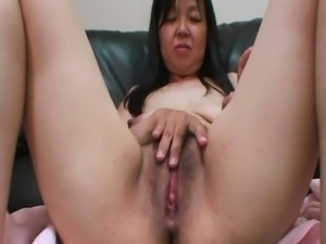 Aged Japanese mature loves using her sex toys