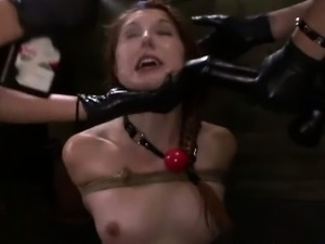 Tied up lesbian gets drilled with big toys