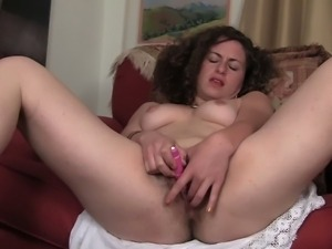 Brunette Lara stroking her tight twat with fingers