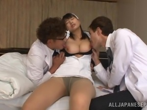 kinky nurse plays with two cocks
