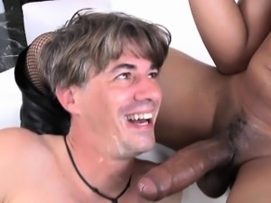 Redhead ebony shemale gives white guy a facial