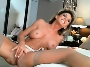 Sexy milf blonde squirt and dildoing pussy