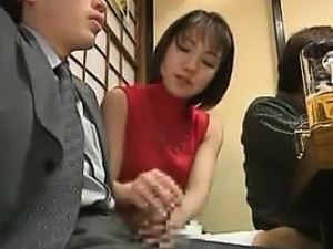 Asian Giving Hand Job During Dinner