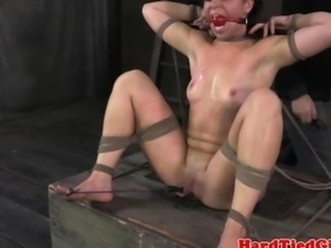 Bdsm sub Mia Gold on end of dildo stick