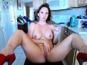 Blonde with great tits gets naked and rubs her slit on a li