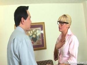 Hot blonde slut in black stockings jerks off a thick cock until it erupts...