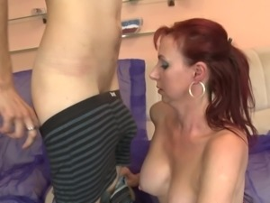 Busty and sexy mature redhead is crazy for his dick