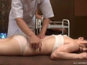 Wonderful Asian babe with natural tits awarding her guy a superb massage