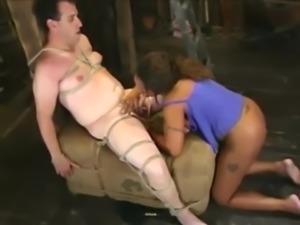 Sexy ebony dominatrix owns his ass