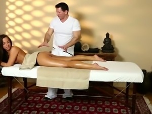 Brutal massage therapist touches tight boobies of sexy young brunette greedily