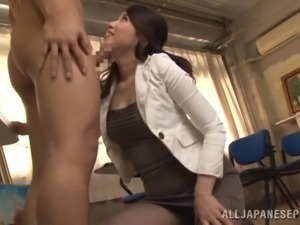 Alluring Japanese MILF in nylon pantyhose giving a terrific blowjob in class