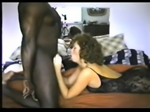 Brunette milf with dark man drawing his black dick that is