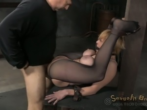 Nasty blonde takes a big black cock up her tight butthole in the dungeon