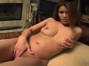 Exotic beauty with a splendid ass Charmane takes a big toy in her cunt