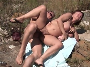 Hairy mature mother fucked in the open air