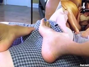 Sexy black girl works a cock with her feet
