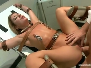 Imprisoned blonde gets tied up and fucked by a doctor