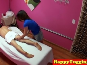 Smalltitted asian masseuse jerks clients cock