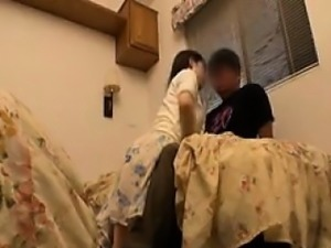 Busty Japanese mom touches herself and gives a young man a