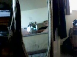 Reflections in the mirror catch her masturbating on the bed