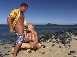 A huge cock invades her tight asshole on the beach