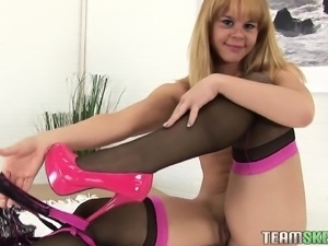 Petite blonde in lingerie sucks a large dick and fingers her wet cunt
